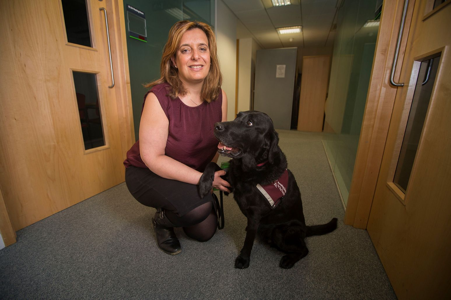 A DWP employee with their hearing dog.